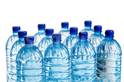 Closeup on rows of mineral water in plastic bottle Stock Photo