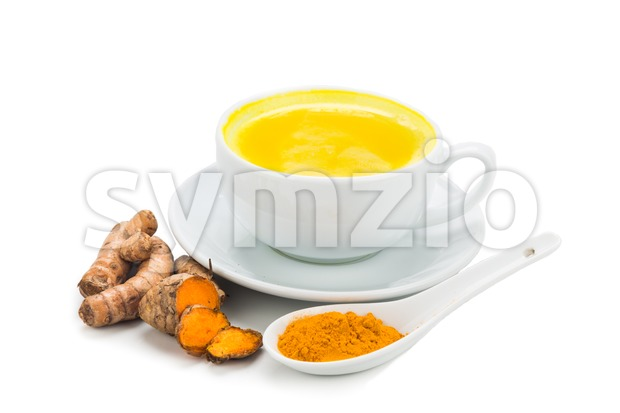 Turmeric with milk drinks good for beauty and health. Stock Photo
