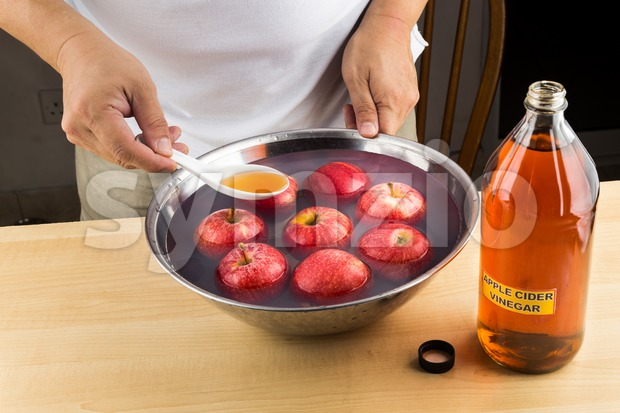Apple cider vinegar effective natural remedy to remove pesticides residue from fruits. Stock Photo