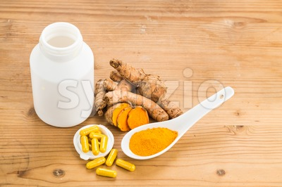 Homemade turmeric capsule from freshly grounded turmeric roots. Stock Photo