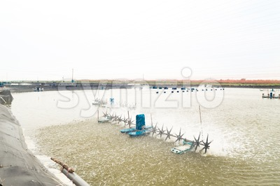 Aquaculture fish and prawn farm with wave creator to circulate water Stock Photo