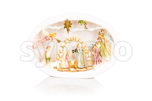 Christmas decorative creche with Holy family isolated on white. Stock Photo