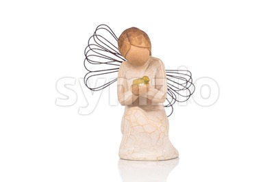 Decorative figurine of an angel praying on white background. Stock Photo