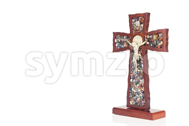 Decorative wooden Catholic Christian Crucifix with isolated white background. Stock Photo