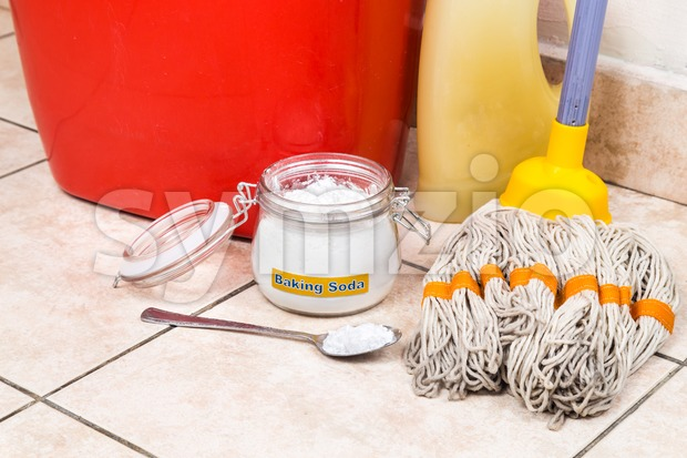 Baking soda with pail, mop, detergent for house cleaning. Stock Photo