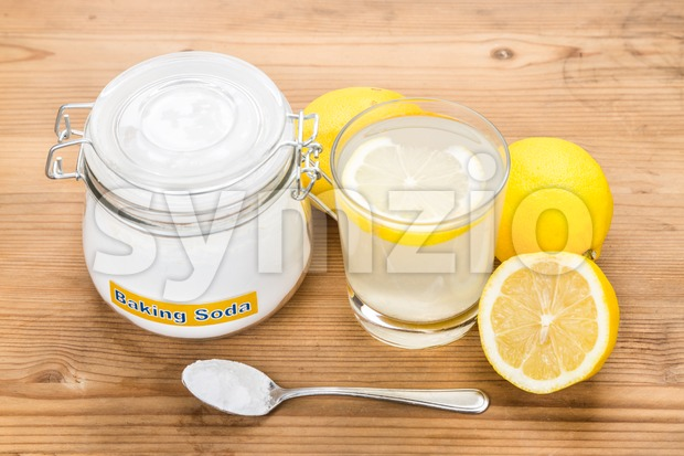 Baking soda with lemon juice in glass for multiple holistic usages