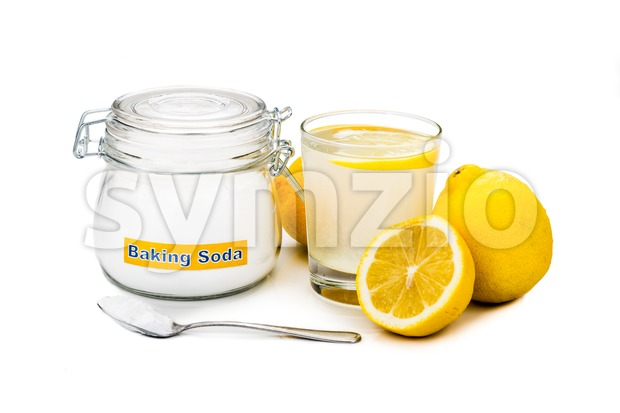 Baking soda with lemon juice in glass for multiple holistic usages. Stock Photo