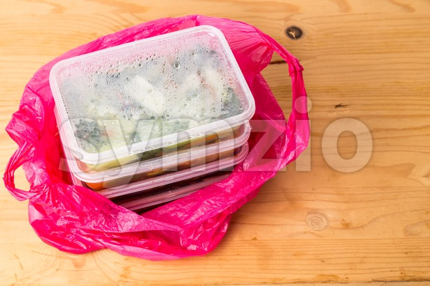Convenient but unhealthy disposable plastic lunch boxes with meals Stock Photo
