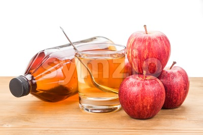 Apple cider vinegar in jar, glass and fresh apple, healthy drink. Stock Photo
