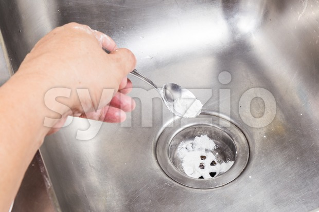 Baking soda poured to unclog drainage system at home. Stock Photo