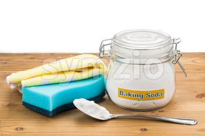 Baking soda with sponge and towel for effective house cleaning. Stock Photo