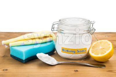 Baking soda, lemon with sponge and towel for effective house cleaning. Stock Photo