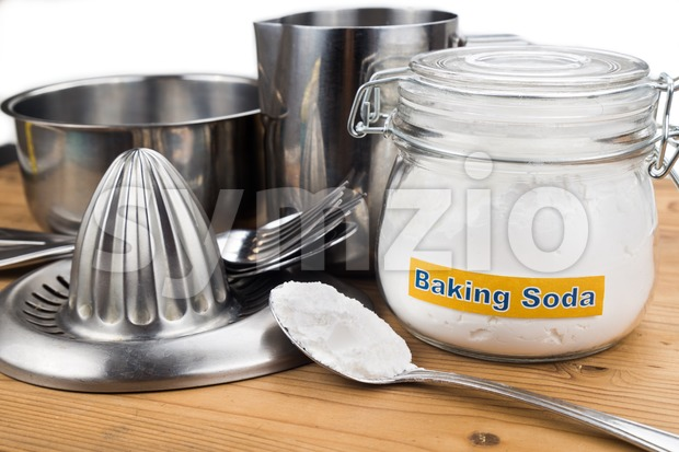Baking soda effective polish of metal kitchenwares. Stock Photo