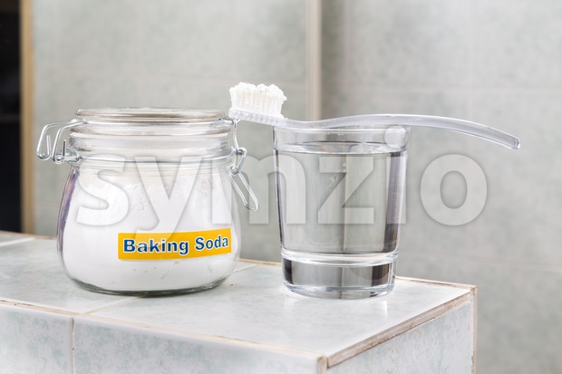 Baking soda used to brighten teeth and remove plague from gums. Stock Photo