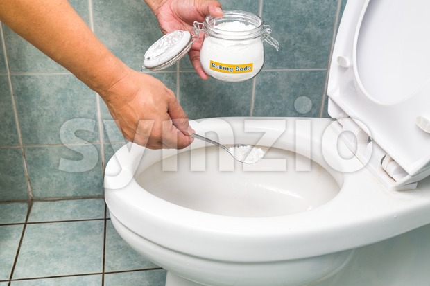 Baking soda used to clean and disinfect bathroom and toilet bowl. Stock Photo