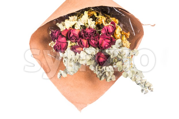 Bouquet of beautiful wrapped dried red roses and flowers