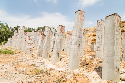 Foundation piling concrete columns at construction site Stock Photo