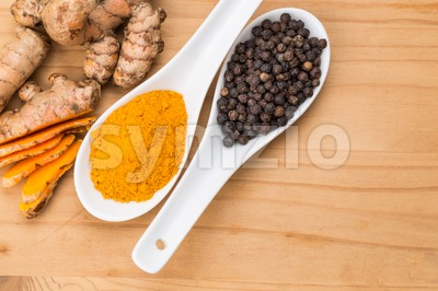 Turmeric roots and black pepper combination enhances curcumin absorption Stock Photo