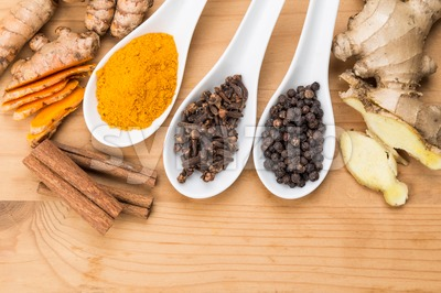 Ingredients for turmeric tea consisting ginger, cinnamon, cloves, black pepper Stock Photo