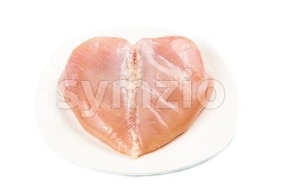 Heart shaped skinless chicken breast meat on a plate Stock Photo