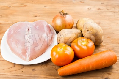 Ingredients to cook double boil Chinese potatoes, carrots, tomatoes soup on wooden table top Stock Photo