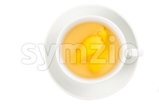 Stimulating hot ginger tea in a cup and saucer Stock Photo