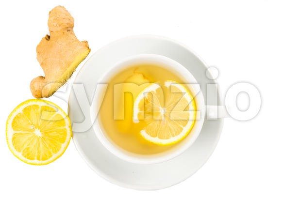 Revitalizing hot ginger tea with lemon in cup and saucer Stock Photo