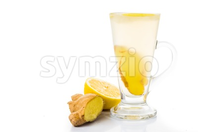 Stimulating hot ginger tea with lemon in glass Stock Photo