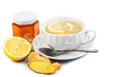 Stimulating hot ginger tea with honey and lemon on white background Stock Photo