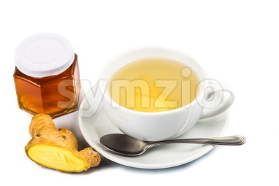 Soothing hot ginger with honey tea in cup and saucer Stock Photo