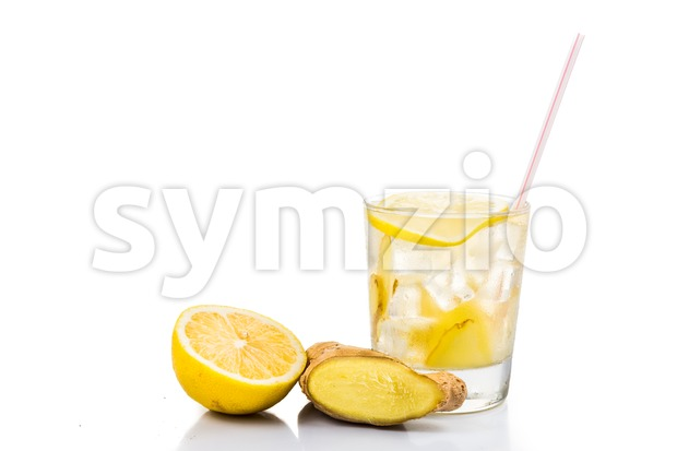 Refreshing ice cold ginger lemon tea in transparent glass Stock Photo