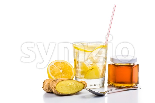 Refreshing iced cold ginger with honey and lemon drinks on white background