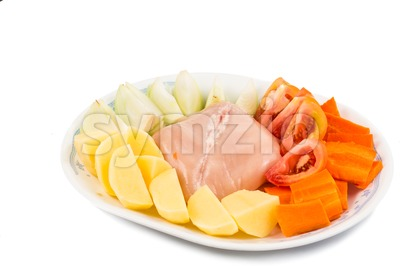 Ingredients to cook double boil Chinese potatoes, carrots, tomatoes soup Stock Photo