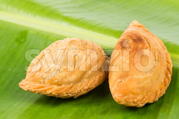 Delicious curry puffs with spicy sweet potatoes fillings Stock Photo