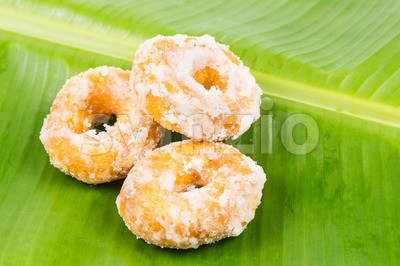 Sweet potatoes dough nut ring on banana leaf, a popular Malaysian sweet delicacy Stock Photo