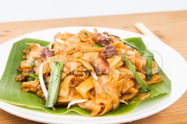 No frills simple Chinese Char Kway Teow or Fried Noodle on banana leaf Stock Photo