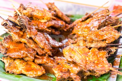 Grilled chicken or popularly known as ayam percik at a street bazaar in preparation for iftar during the fasting month of Ramadan Stock Photo