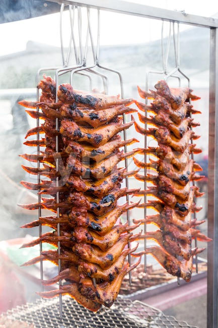 BBQ chicken wings at a street bazaar during the fasting month of Ramadan Stock Photo
