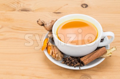 Healthy turmeric tea with black pepper, cinnamon, cloves and ginger Stock Photo