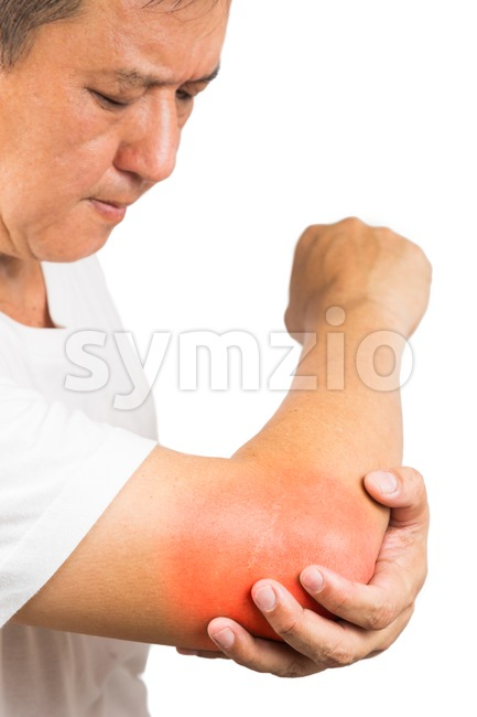 Matured man suffering from sore and painful elbow Stock Photo