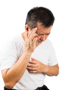 Matured man suffering from painful headache Stock Photo