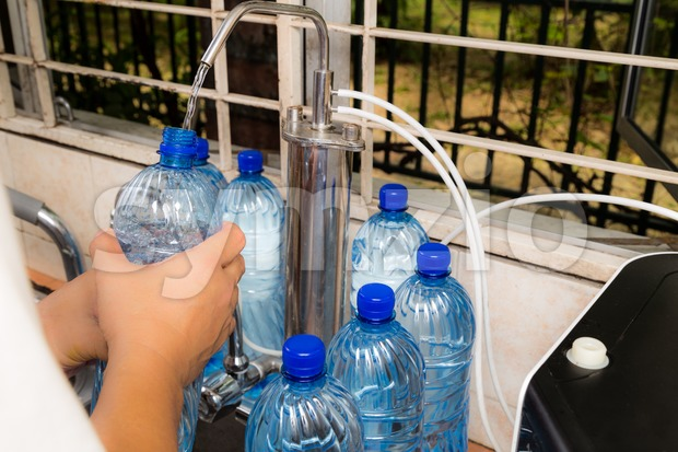 Person recycle empty plastic bottle from filtered tap water deemed as unhealthy practice