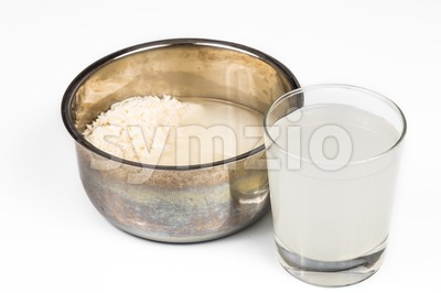 Water from rice rinse can be used as natural plant fertilizer Stock Photo