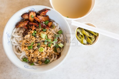 Delicious Chinese udon noodle with minced and BBQ pork Stock Photo