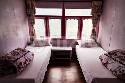 Typical basic room with single beds at Nepal tea houses for hikers and travellers along trekking routes Stock Photo