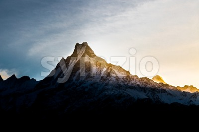 Sunrise over East of Mount Machapuchare Stock Photo