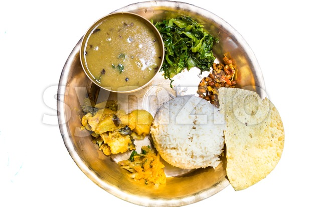 Dal Bhat, traditional Nepali meal platter with rice, lentils soup, vegetables, poppadum and spices