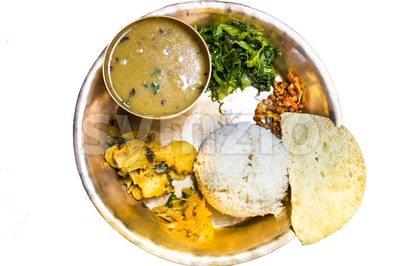 Dal Bhat, traditional Nepali meal platter with rice, lentils soup, vegetables, poppadum and spices Stock Photo