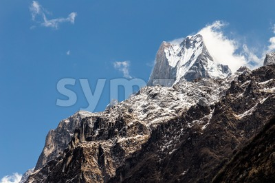 Peak of Mount Machapuchare or popularly known as Fish Tail as viewed from Bamboo village, Nepal Stock Photo
