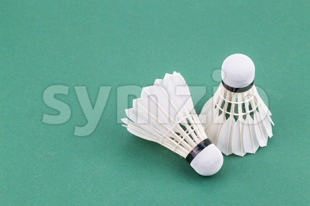 Two new badminton shuttlecock  on green court mat Stock Photo